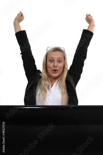 Ecstatic blond businesswoman