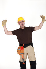 Cheering construction worker