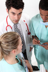 Three hospital staff members having discussion