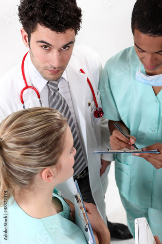 Three hospital staff members having discussion