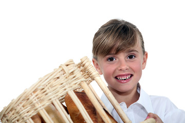 Young girl holding a bread basket