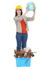 craftswoman raising a globe