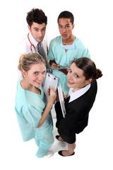 Hospital staff huddling
