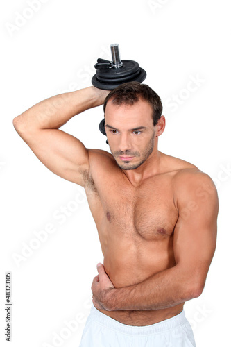 young man with dumbell