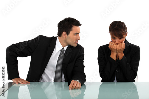 Businessman reassuring scared colleague