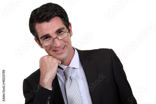 Excited businessman in glasses