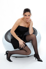 Sexy woman sitting in a chair