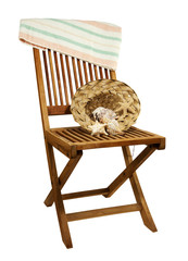 teak deck chair with towel, sun hat and seashells