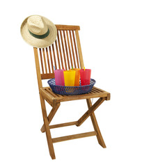 teak deck chair with sun hat and drinks, isolated