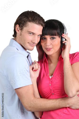 brunette with earphones and boyfriend cuddling