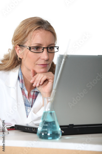 Chemist working at a laptop computer