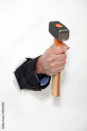 male hand holding hammer
