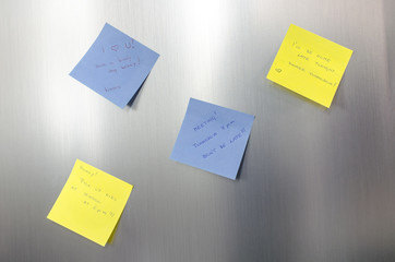 Reminder sticky notes with handwritten text