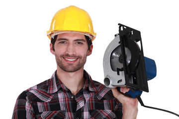 Man proudly holding electric saw