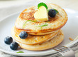 Stack of blinis or pancakes with blueberries