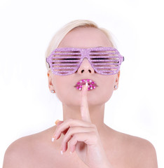 fashion girl in glamour glasses with finger on her lips