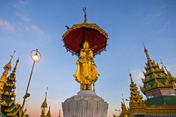 Buddha statue on top of pagoda around Shwedagon Pagoda - Yangon,