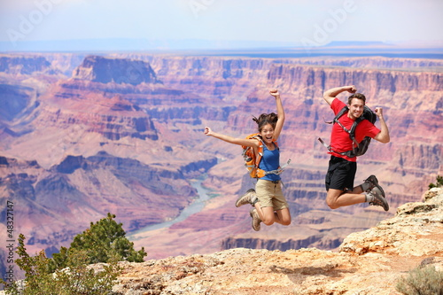 Happy people jumping in Grand Canyon