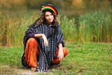 Young rastafarian woman in autumn park