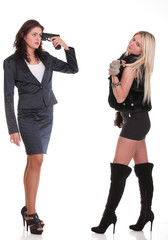 Two diverse women one with pistol pointing on her head isolated