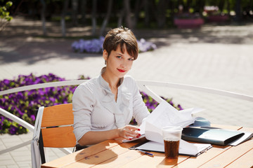 Young businesswoman at a sidewalk cafe