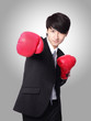 businessman punching and hitting with boxing gloves