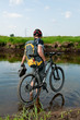 guy - a professional cyclist. Crossing the river