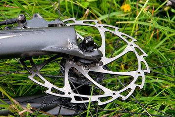 Bike in the field. Close-up bicycle disk brake