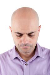 Worried bald  man looking down.