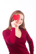 woman holding heart shape to her face