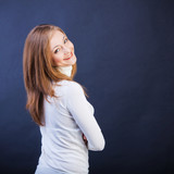 smiling woman sidewise with crossed arms