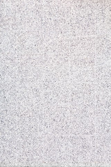 White marble tiles with black specks on a wall