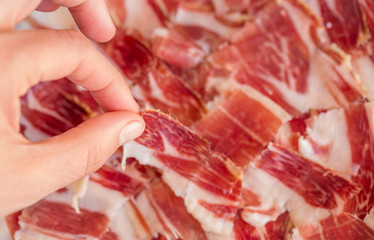 Picking serrano ham