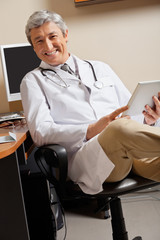 Happy Doctor Holding Digital Tablet