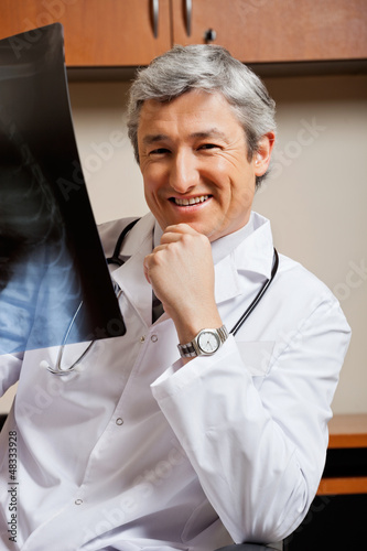 Happy Radiologist With X-ray