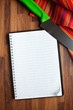 blank recipe book and kitchen knife