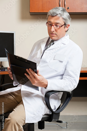 Mature Male Doctor Reading