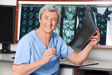 Happy Radiologist Holding X-ray