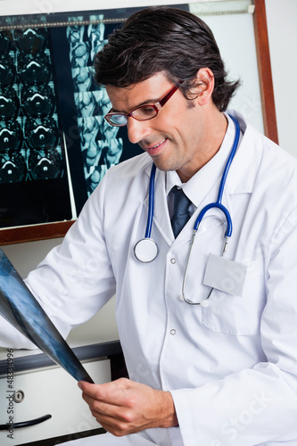 Male Radiologist Reviewing X-ray