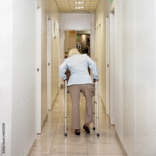Woman With Walker In Corridor