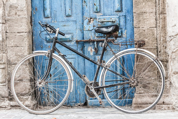 White bike in front of a shop in Marrakesh,Morocco