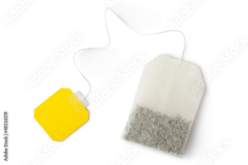 Teabag with yellow label. Top view.