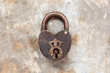 Vintage padlock on an iron grunge background