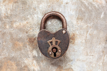 Vintage padlock on an iron grunge background