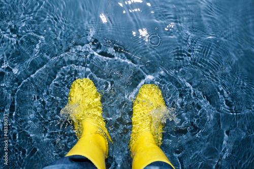 canvas print picture rubber boots splashing in the water