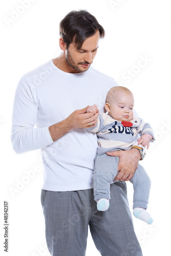 Loving father holding his small baby