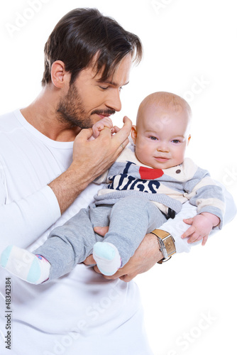 Young father cradling his baby on his arm