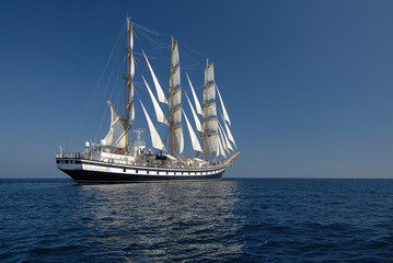 Sailing frigate under full sail in the ocean