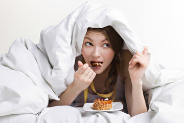 woman eating under cover