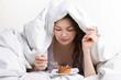 girl eating cake under cover